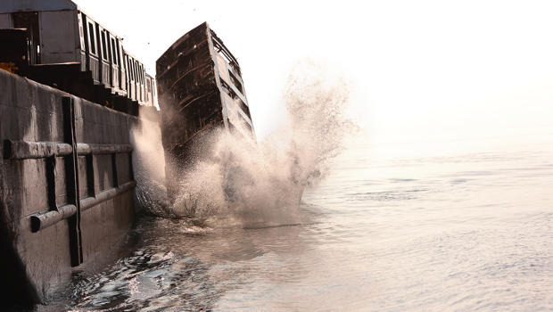 Surreal Photos of Subway Cars Being Thrown Into the Ocean