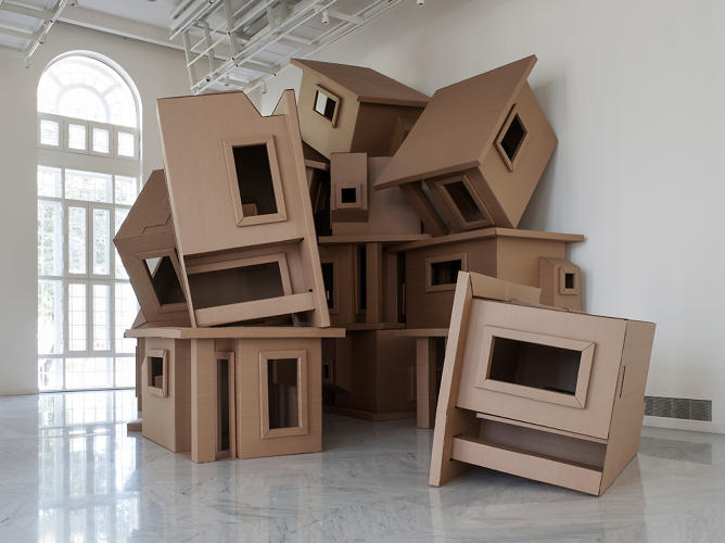 <p>Cardboard becomes casas in El Barrio, which sees a seemingly haphazard pile of paper homes stacked high in the exhibition space. The installation &quot;represents the precariousness and chaos with which urban life of modern societies are constructed.&quot;</p>