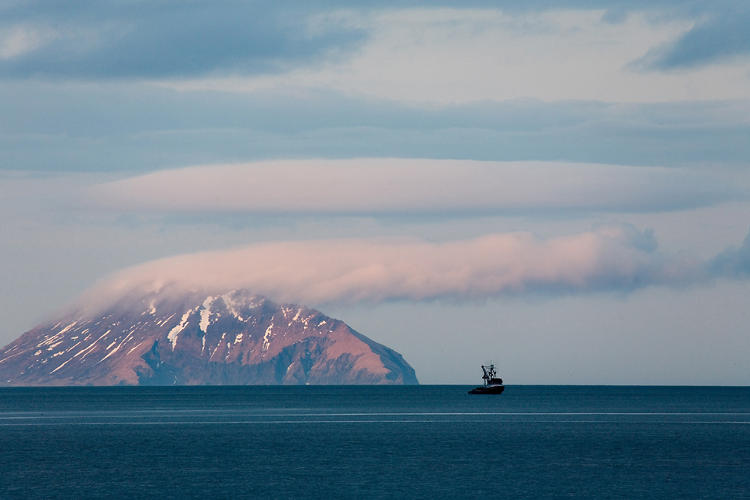 <p>A lone commercial herring seiner cruises along Nunavachak Bay. Round Island in the distance, summer home to thousands of walrus, and part of the Walrus Islands State Game Sanctuary. Togiak Bay, Bristol Bay, Alaska, Bering Sea and Kamchatka ecoregion, United States.</p>