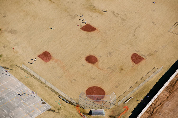 <p>He sees sports images, such as this photo of a baseball diamond in Arizona, as a reenactment of real life.</p>