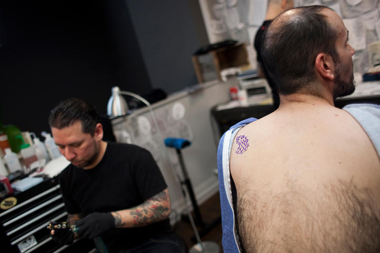 <p>A fan with his stencil placed, waiting for the tattoo.</p>