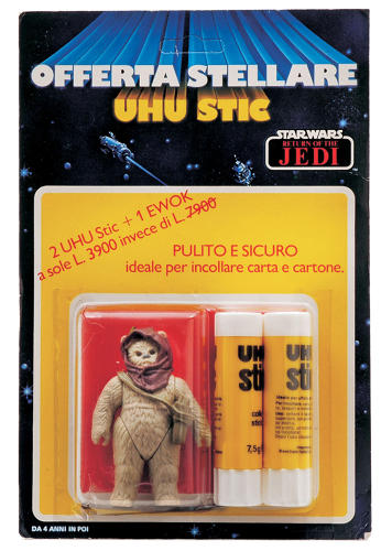 <p>There are many ways to sell action figures. This is probably one of the strangest. From Italy, our little Ewok friend is packed with two Uhu glue sticks. It's still not clear to me which product they were trying to sell.</p>