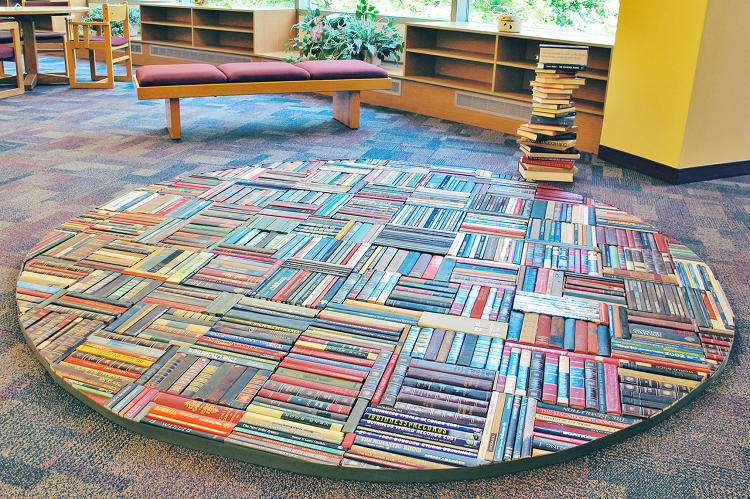 <p>Citing nature, language, and dreams as key influences in her work, Pamela Paulsrud used several dozen books to create this floor sculpture.  She incorporates  books in her work as a way of exploring a new language, a new perspective, and a new way to tell a story.</p>