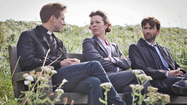 <p>Reverend Paul Coates (Arthur Darvill) confers with Alec Hardy (David Tennant) and DS Ellie Miller (Olivia Colman).</p>