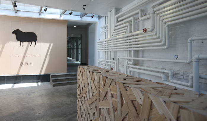 Ad agency office looks like house sawed in half co for Interior design agency shanghai