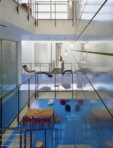 <p>Here, architect Robert M. Gurney renovated a more than 100-year-old building in D.C. to resemble a modernist funhouse, with blue epoxy floors, skylights, and precarious-looking bridges every which way.</p>