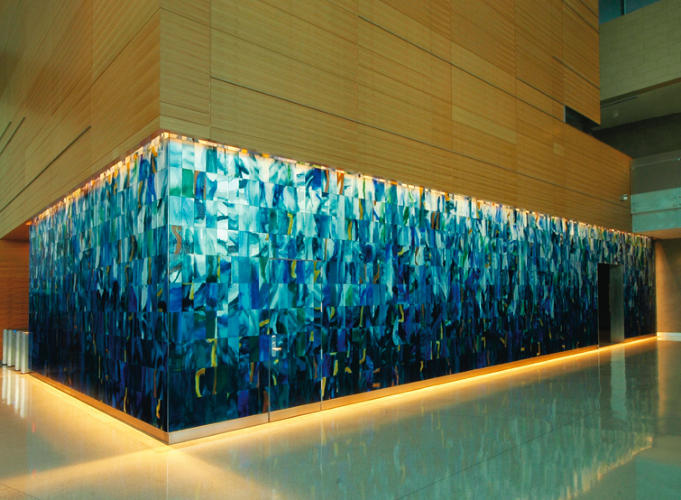 <p>This installation for the lobby of the California State Teachers' Retirement System in Sacramento is made up of handblown sheet glass with glass enamels laminated to mirrors. The work is inspired by the confluence of the nearby American and Sacramento Rivers.</p>