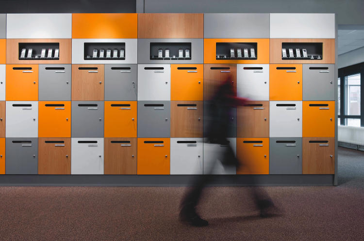 <p>&quot;As we go digital,&quot; van Meel says, &quot;mail areas will be the first to drop from the list&quot; of mandatory workplace features. In the meantime, managers still need to designate space for snail mail. This office in Utrecht cleverly incorporated mail slots into employees' lockers.</p>