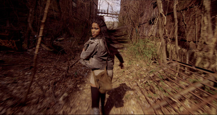 <p>Actress Kettie Jean runs through an abandoned section of Staten Island in <em>The Silent City</em>.</p>