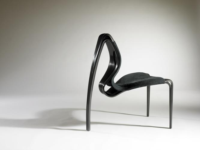 <p>Cork, Ireland-based designer Joseph Walsh used graphite and lacquer to create an eye-popping swoop in this sculptural chair. A closer inspection of  Enignum  Chair II reveals a dark suede (and surprisingly comfortable) seat.</p>  <p>DUBH-Dialogues in Black is on view through November 13.</p>