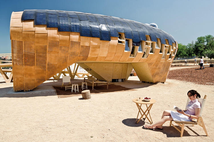 <p>Since the project was designed for the hot Madrid summer, the team created shaded outdoor space by raising three legs of the building off the ground. The legs contain services, equipment, and water.</p>