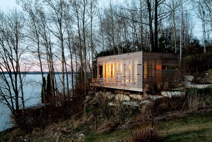 "<p>The architect Michael Taylor describes this one-room house, located on the southern shore of Lake Simcoe, as a ""simple but sophisticated Canadian bunkie."" Despite its seemingly complex pattern of louvers, the entire structure was constructed from prefabricated sections in four weeks.</p>"