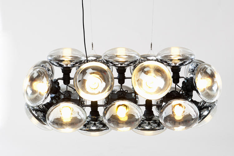 <p>Incandescent bulbs are being phased out in the U.S. and Europe -- great news for the environment, but terrible news for designers who love incandescents' warm, orangey glow. Dixon's Bulb Chandelier tries to turn energy-efficient bulb into a thing of beauty, by clustering together oversized CLFs.</p>