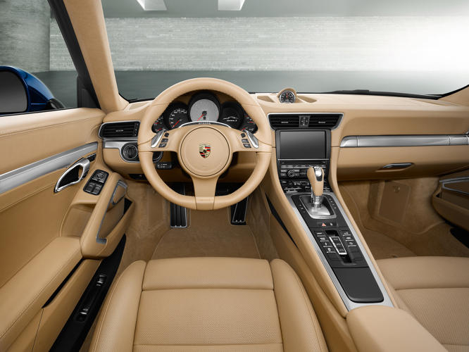 <p>The shift lever in the new 911 is placed far higher than you'd find in a family car--part of the many subtle cues that reference race cars.</p>