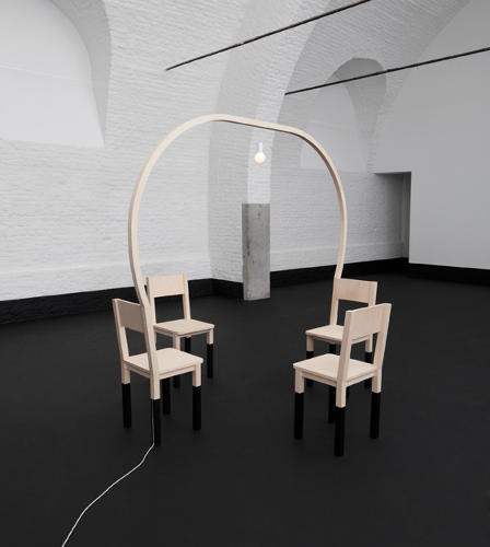 <p>A wooden archway supports a light suspended over four chairs. The installation provides illumination without an elaborate chandelier.</p>
