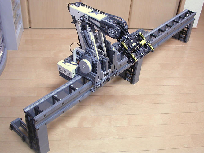 <p>Its most complicated piece is this five-axis robot arm, controlled by Mindstorms NXT.</p>