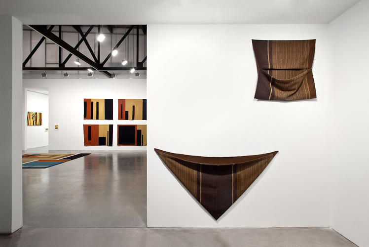 <p>Recalling work from her early career, some of the fabrics are conceived of as ponchos or garments.</p>