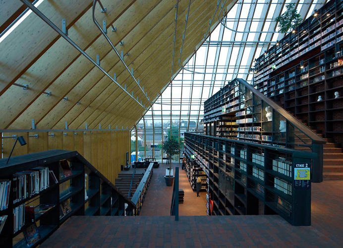 <p>The library, all in glass in timber, is the centerpiece of the project.</p>
