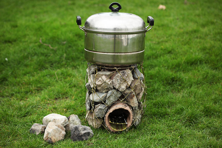 <p>Liz To's thab. cooker utilizes wire hangers from the dry cleaner to create a more effective stove for Tibetan nomads.</p>