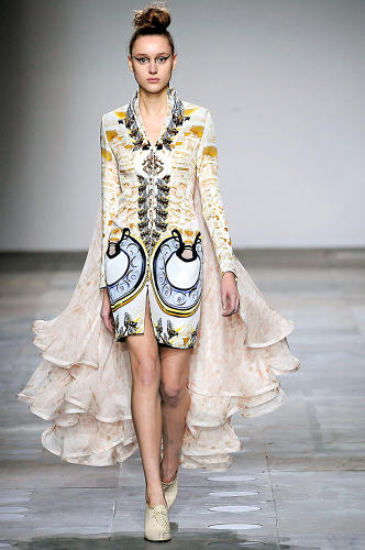 <p>Katrantzou's work features dense, lush collages that she creates in Photoshop. See the rotary phone, here?</p>