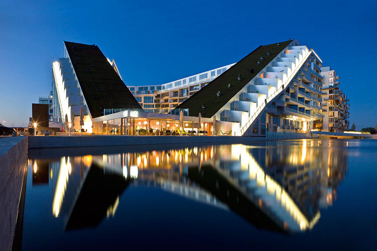 <p>8 House was the Bjarke Ingels Group's bold approach to reinventing housing. Designed around the idea of a residential block, the &quot;House&quot; has a bow-tie shape and a cycling path that runs up to its 10th floor, encouraging interaction among neighbors.</p>