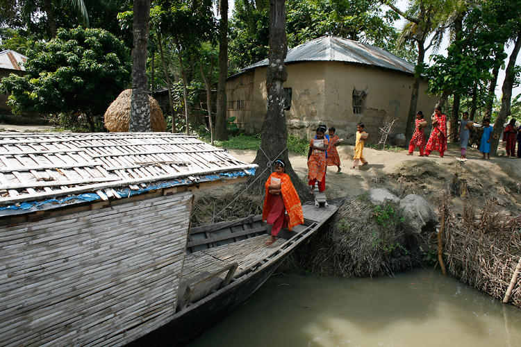 <p>The boats come right up to children's doorsteps, and reward them with solar-powered lamps for their homes--provided they come to school regularly.</p>