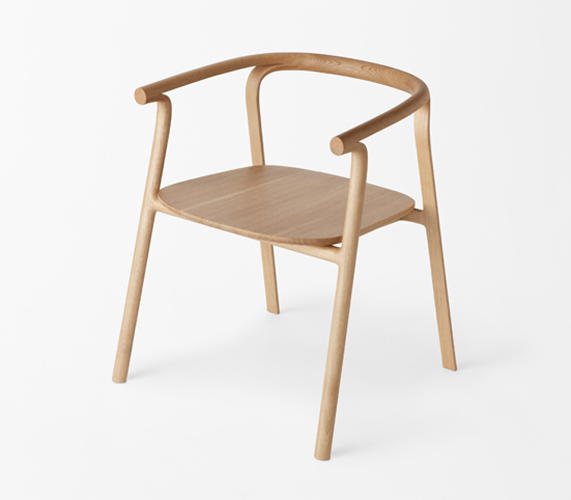 <p>For example, the backrest of this chair is split in two, one half sloping to become a leg and the other continuing to serve as an arm rest.</p>