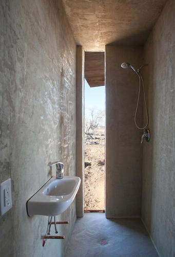 <p>The bathroom is hidden in a nook behind the wall.</p>