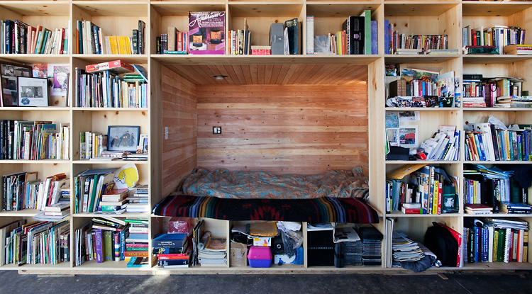 <p>And the bed is built into the 45-foot-long bookshelf that edges one side of the home.</p>