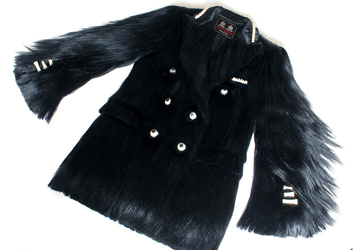 <p>The jacket comes complete with glass eyeball buttons on the double-breasted lapels.</p>