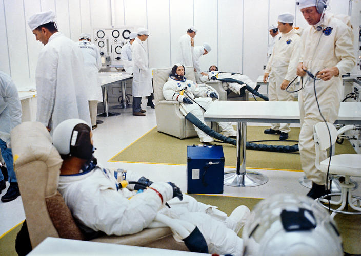 <p><strong>First Manned Apollo Prep (Apollo 7)</strong><br /> Views of the Apollo 7 crew in suiting room, egress from transfer van, command module ingress in the White Room, and the launch of Apollo 7. (The White Room is environmentally controlled space on the launchpad with reliners for the suited astronauts).</p>