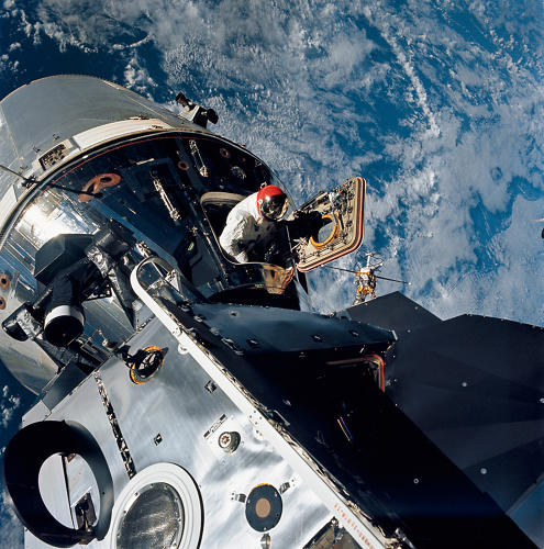 <p><strong>Sky High</strong><br /> Excellent view of the docked Apollo 9 Command and Service Modules CSM and Lunar Module LM, with Earth in the background, during astronaut David R. Scott's stand-up Extravehicular Activity EVA, on the fourth day of the Apollo 9 Earth-orbital mission. Scott, command module pilot, is standing in the open hatch of the Command Module CM. Film magazine was E,film type was SO-368 Ektachrome with 0.460 - 0.710 micrometers film / filter transmittance response and haze filter,80mm lens.</p>