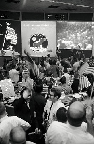 <p><strong>Touchdown</strong><br /> View of Mission Control Center celebrating conclusion of Apollo 11 mission. Overall view of the Mission Operations Control Room in the Mission Control Center, bldg 30, Manned Spacecraft Center (MSC), showing the flight controllers celebrating the successful conclusion of the Apollo 11 lunar landing mission.</p>
