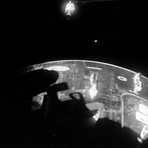 <p><strong>Disaster Strikes</strong><br /> This view of the damaged Apollo 13 Service Module (SM), with the Moon in the distant background, was photographed from the Lunar Module/Command Module following SM jettisoning. The Command Module (CM), still docked with the Lunar Module LM, is in the foreground. An entire panel on the SM was blown away by the apparent explosion of oxygen tank number two located in Sector 4 of the SM. (The astronauts are supposed to be inside that tiny, glowing piece that's drifting away.)</p>