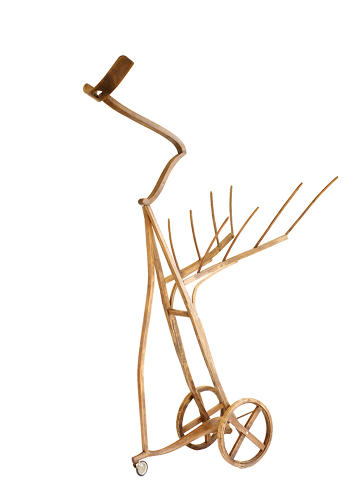 <p>Antique brooms and wheels make for a less figural piece.</p>