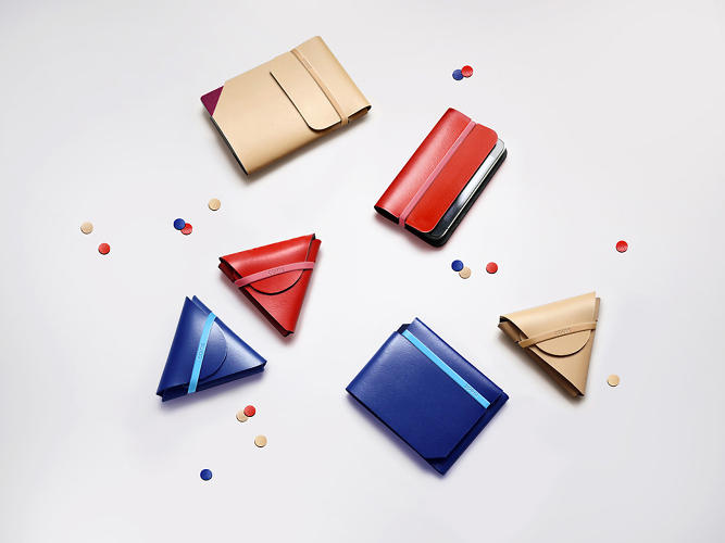 <p>The collection includes a wallet, coin case, iPhone holder, and passport holder.</p>