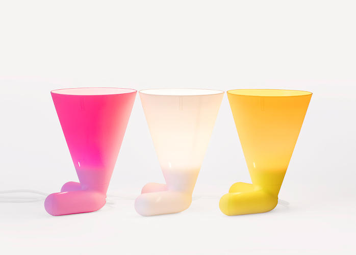 <p>The two-legged light is offered in cheery white, pink, and yellow hues.</p>