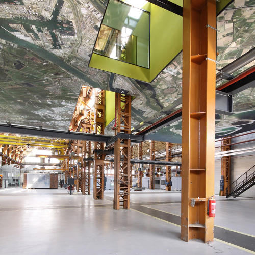 <p>A massive Google Maps mural showing Rotterdam is affixed to the ceiling of the first floor.</p>