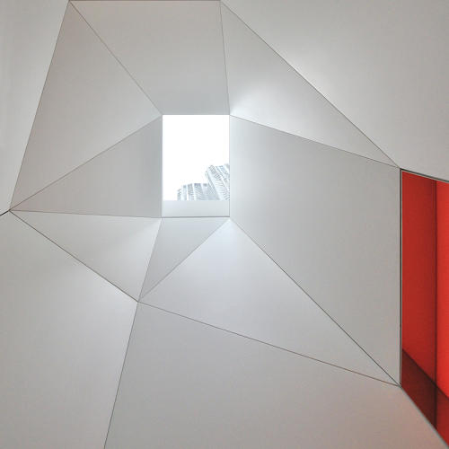 <p>Aside from these whimsical touches, the space is a celebration of geometry. Here's the skylight in the foyer.</p>