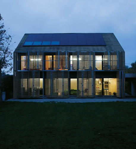 <p>Karawitz Architecture designed this two-story house in Bessancourt, France, 18 miles northwest of Paris. The sloped roof is clad in solar thermal panels, which provide most of the hot water for the home, and photovoltaic panels, which capture solar energy.</p>