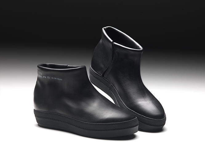 <p>The sneaker-boots are about as minimal as a pair of leather shoes can get.</p>