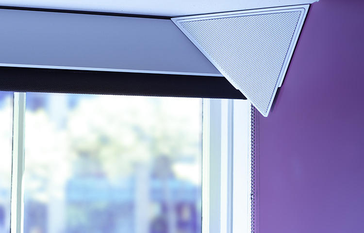 <p>Tiptop, designed by a trio of Stanford D.School students, is a pyramid-shaped, Bluetooth speaker that mounts into the corner of a room.</p>