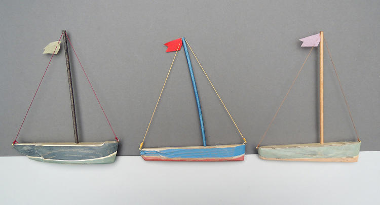<p>Artist Victor Stuart Graham carved these boats from found driftwood.</p>