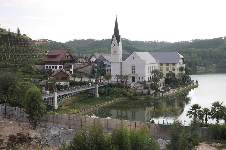 <p>News has spread about China's counterfeit towns, which duplicate European landmarks, neighborhoods, and even whole villages, like Hallstatt above.</p>