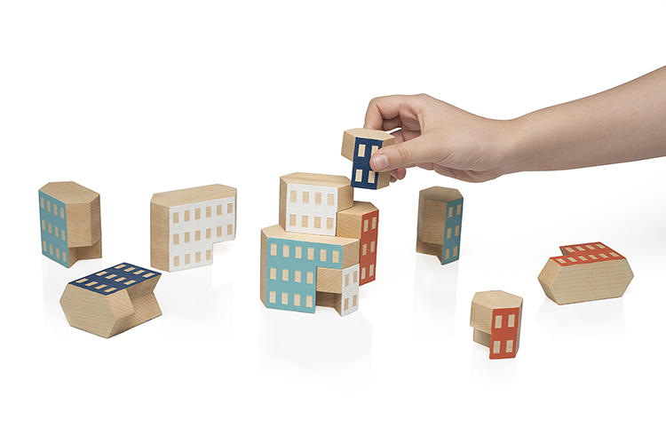 <p>Twenty-two students in the Rochester Institute of Technology's Metaproject03 were given the directive to make a &quot;universal toy&quot; out of wood that would fit in as a product in Areaware's playful collection. Blockitecture, by James M. Paulius, was one of the three winners.</p>