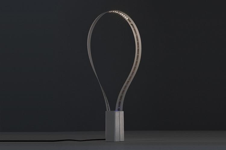 <p>The design is simple: two magnetic base components combined by a ribbon of LED lights.</p>