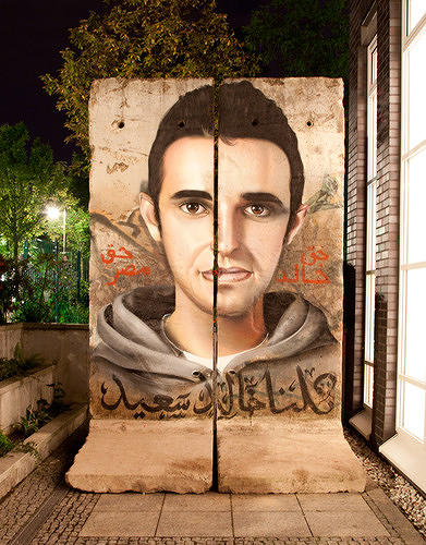 <p>Case McClaim painted this image of Khalid Said, who was killed by Egyptian security forces, on the Berlin Wall. Photograph by Joel Sames.</p>
