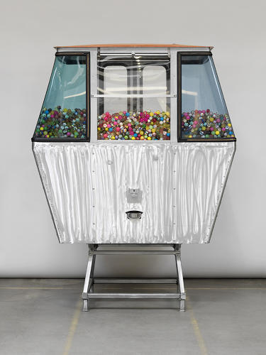 <p>For Miami/Basel 2013, three Swiss designers commissioned seven artists to reimagine the classic Verbier ski gondolas as works of art. Wardlaw converted the chair lift into a giant-sized gumball machine, seen here.</p>