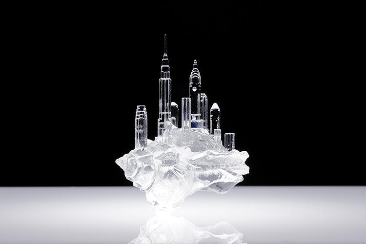 <p>Each of the plastic shells is embellished with micro-architectural details, such as a miniature skyline…</p>