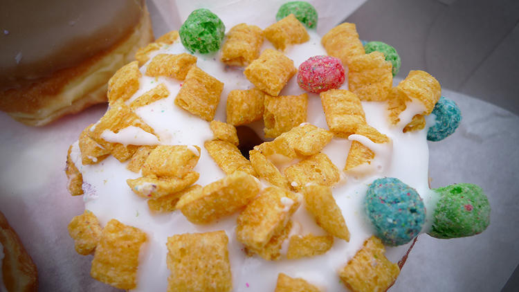 <p>Captain Crunch--a raised yeast doughnut with vanilla frosting and Captain Crunch.</p>